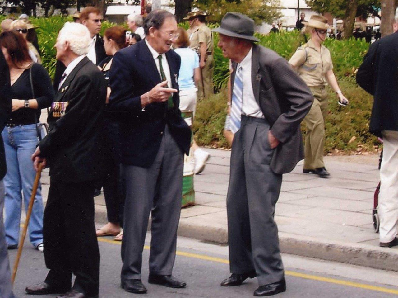 ANZAC Day 2005, Adelaide. Pictured are from left, Norman Lloyd FIEBIG (SX12795, corporal, 2/43rd Battalion), Lenard George BROWN (SX31918, Private with the 2/43rd Battalion) and Maurice La Rue PREST (SX9160, Lance corporal with the 2/43rd Battalion). From the collection of the late Len BROWN.