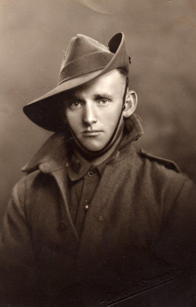 Studio portrait of SX11236 Mervyn James DENTON who was killed in action on 3 August 1941 during the Battle of Tobruk; he was serving with the 2/43rd Battalion. From the Irene DIXON (nee DENTON) family collection.