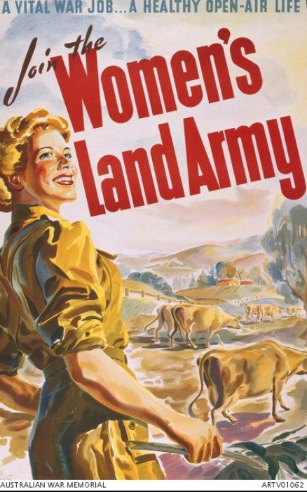 An Australian World War Two Women's Land Army recruitment poster. The poster depicts a smiling, healthy young woman in the foreground wearing WLA uniform holding a stick in her right hand. In the background is an idealised rural scene possibly a dairy farm with cows and rolling hills. The title text is superimposed over this in the top half in red. From the Australian War Memorial's collection, no ARTV 06446.