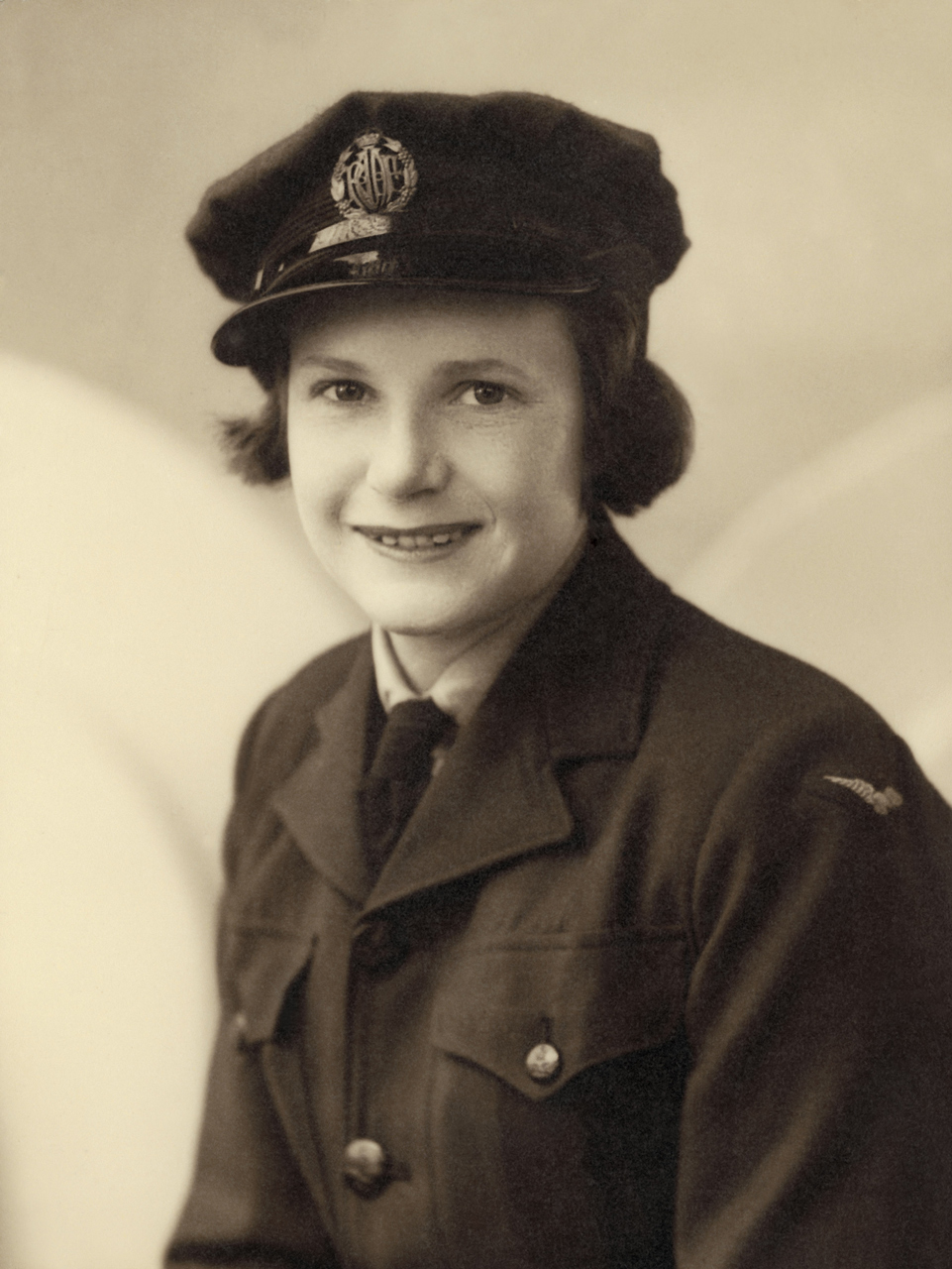 A sepia version of the studio portrait of Mollie, taken circa 1944. The photographer is unknown